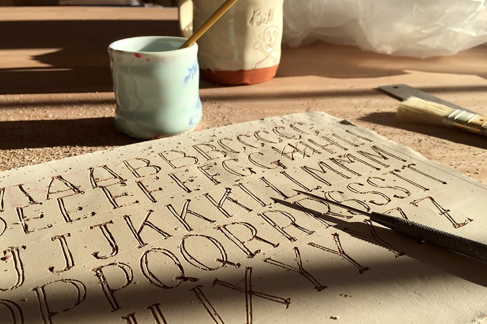 Drawing the alphabet in clay so that we can then have a font to type set each phrase in Photoshop